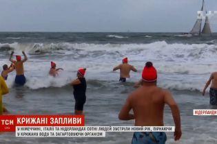 Пірнання в крижану воду і стрибки з мосту: європейці здивували святкуванням Нового року