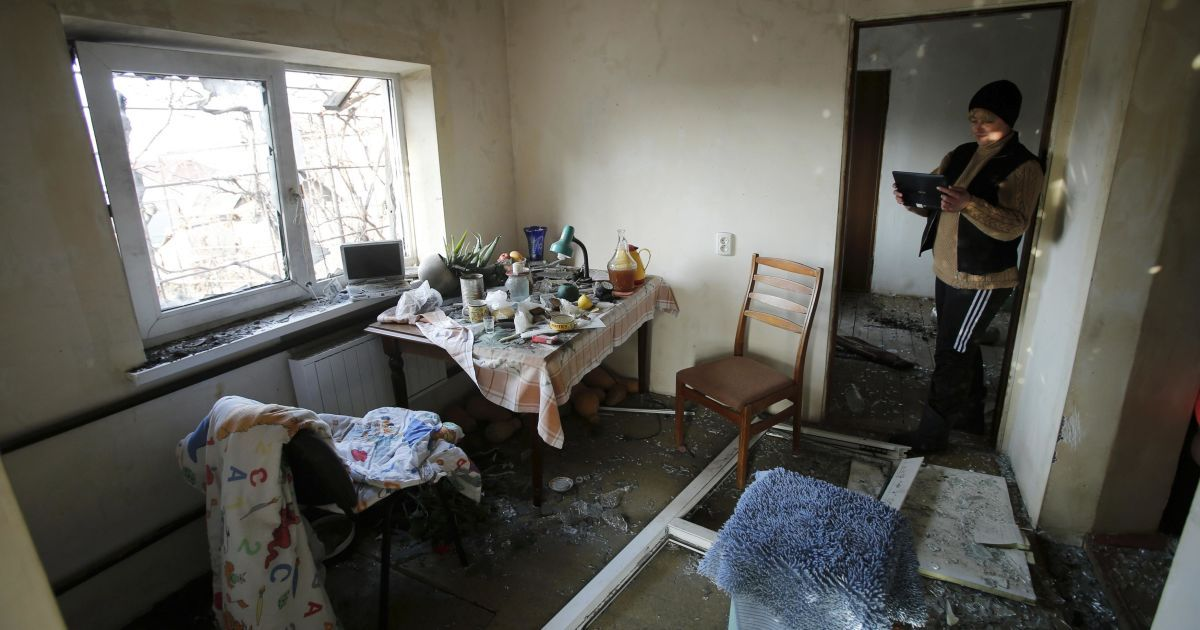 Поселок Красный Пахарь после мощного утреннего обстрела @ Reuters