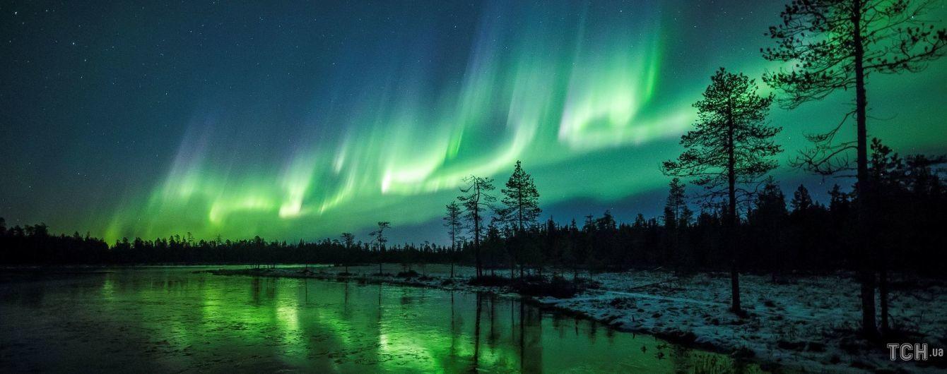Сказочное изумрудное небо. Reuters опубликовало зрелищные фото полярного сияния