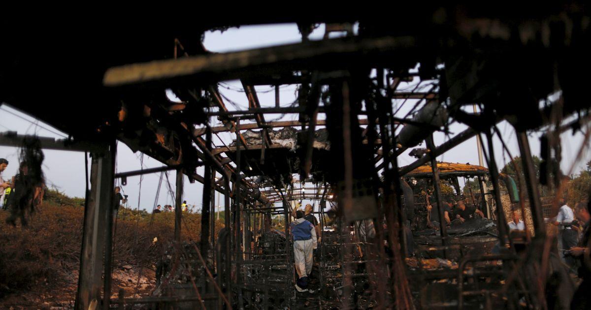 Судово-медичні експерти працюють на місці вибуху автобусу в Єрусалимі. @ Reuters