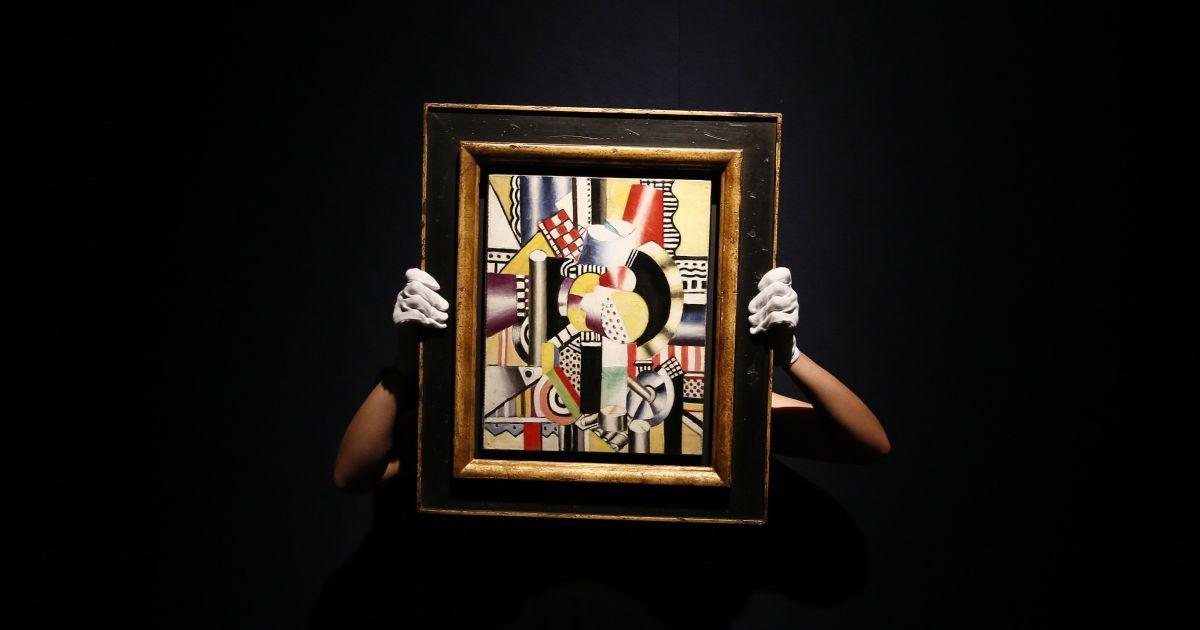 """Працівник галереї позує з картиною """"Двигун"""" Фернана Леже під час прес-показу творів мистецтва імпресіоністів і сучасного мистецтва на аукціоні Крістіс у Лондоні. Картину, за оцінками, продають за 4-6 млн британських фунтів стерлінгів. Її будуть виставляти на аукціон 2 лютого. @ Reuters"""