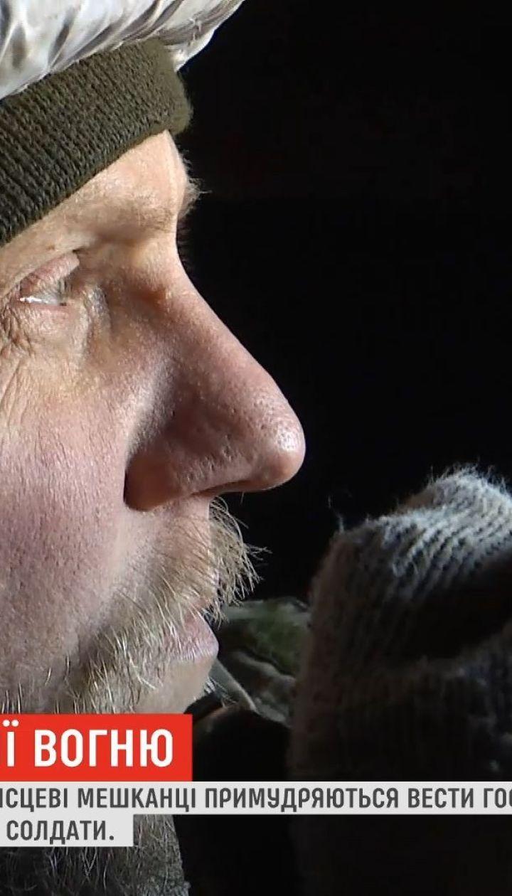 Жизнь на линии фронта: украинские военные помогают местным жителям в Водяном