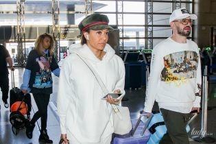 В штанах з дірками та червоних чоботях: Мел Бі з бойфрендом заскочили в аеропорту