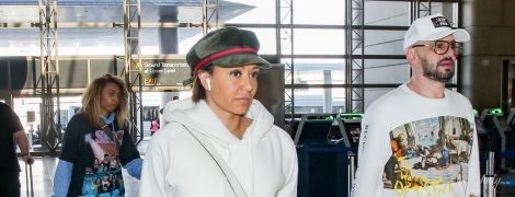 В брюках с дырками и красных сапогах: Мел Би с бойфрендом подловили в аэропорту