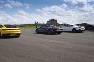Новый Porsche 911 испытали в гонке с культовыми спорткарами. Видео