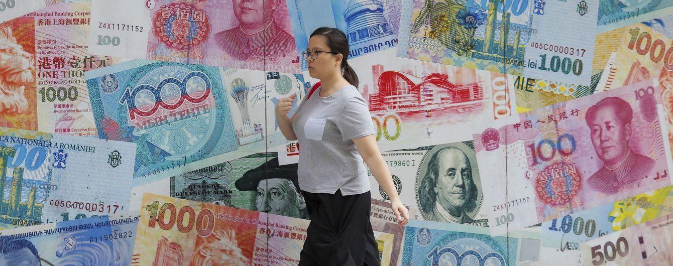 Світові фінансові ринки струсонуло через торговельну війну Трампа з Китаєм. Які ризики та вигоди для України