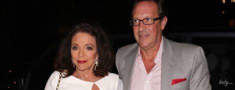 В белом платье и за руку с мужем: 86-летняя Джоан Коллинз на вечеринке в Лондоне