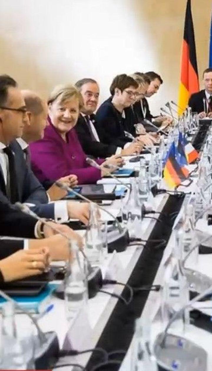 Меркель и Макрон поприветствовали прогресс в Минских переговорах