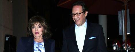 У красивій сукні і за руку з чоловіком: 86-річна Джоан Коллінз сходила до ресторану