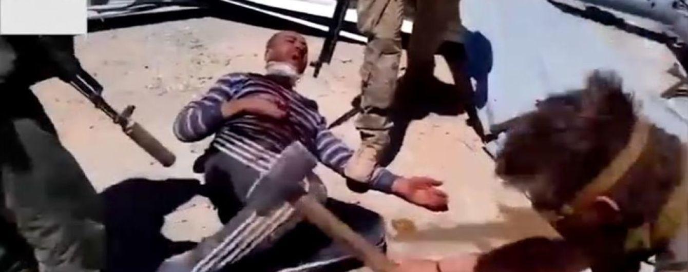 Били кувалдою, відтяли голову та руки, а потім спалили. Журналісти знайшли одного із катів-росіян, які вбили людину в Сирії