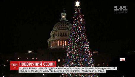 Рождественские елки зажгли сразу в нескольких городах США
