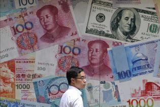 """США и Китай договорились о """"первой фазе"""" торгового соглашения"""