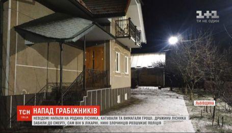 Четверо невідомих у масках катували родину керівника лісгоспу на Львівщині