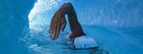 В одних только плавках: британец первым в истории проплыл под ледником Антарктиды