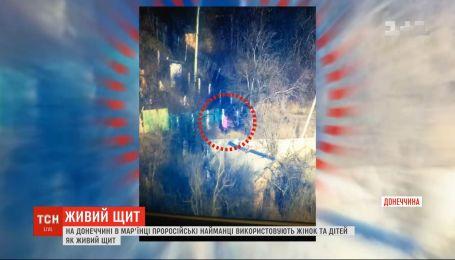 За спинами дітей і жінок: бойовики взяли на озброєння тактику Путіна