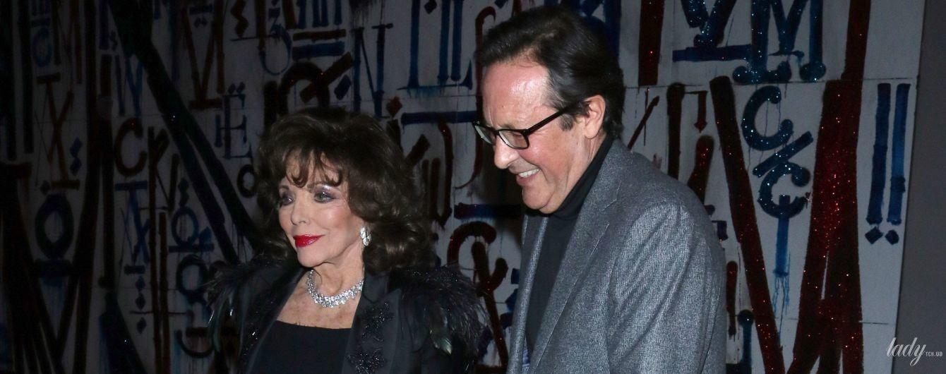 В елегантній сукні-футлярі і на шпильках: 86-річна Джоан Коллінз з чоловіком сходили в ресторан