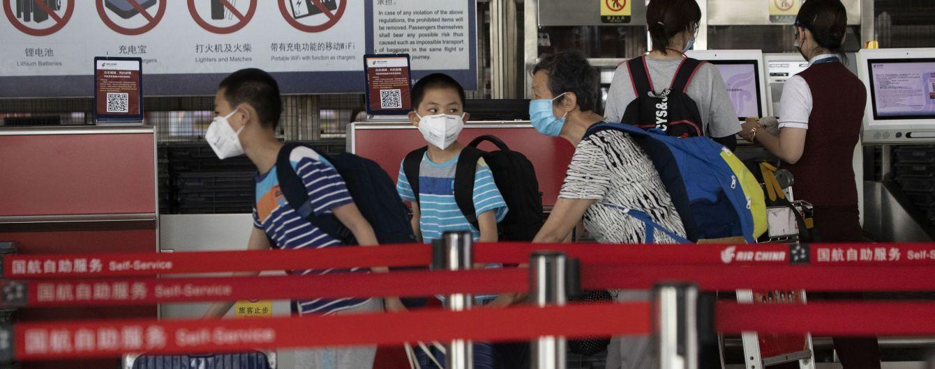 Спалах коронавірусу в Китаї: у Пекіні скасували майже 70% авіарейсів