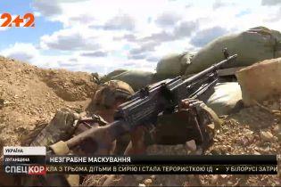 Российские оккупанты в Луганской области маскируются под американским флагом