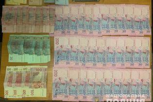 Под Киевом полиция задержала подозреваемого в подкупе избирателей
