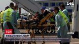 Новости мира: 15 украинских бойцов полетели в Германию на лечение