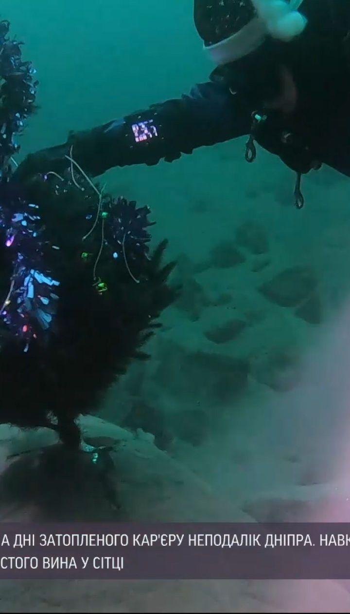 Старый Новый год под водой: дайверы установили елку на дне затопленного карьера