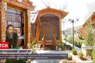 Новости Украины: фонтаны и дом для попугаев - что происходит на кладбище в Днепропетровской области