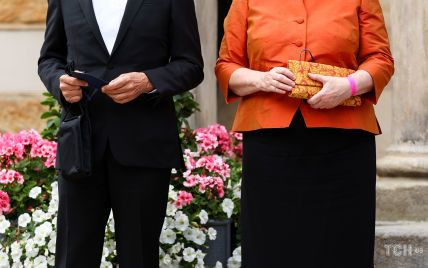 В мандариновом жакете и длинной юбке: Ангела Меркель восхитила элегантным образом на фестивале