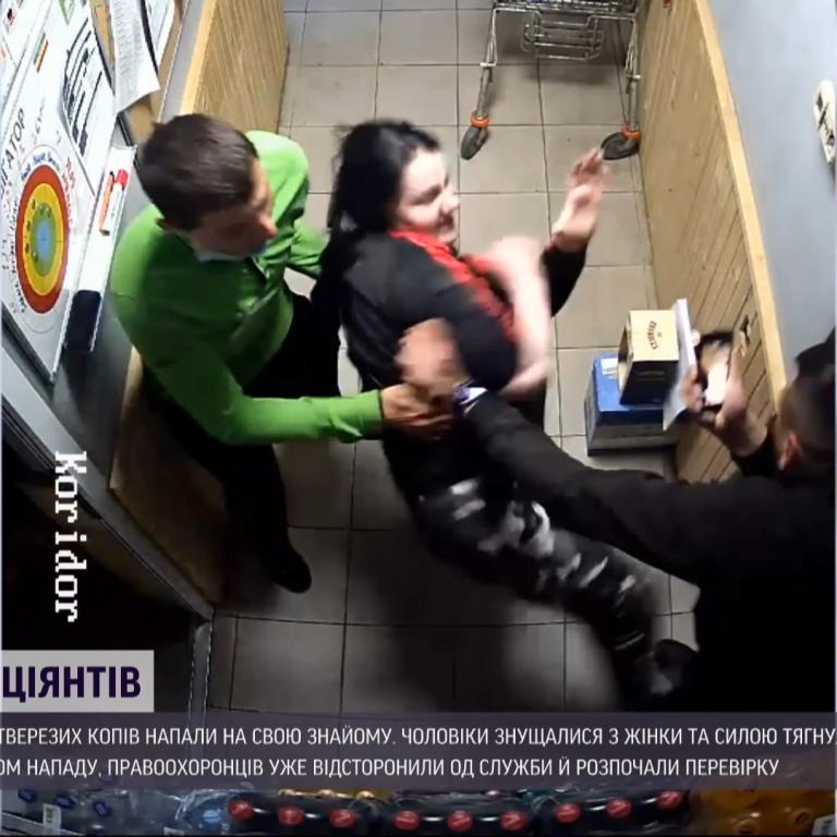 Колотили женщину прямо на заправке: на Закарпатье пьяные полицейские напали на знакомую