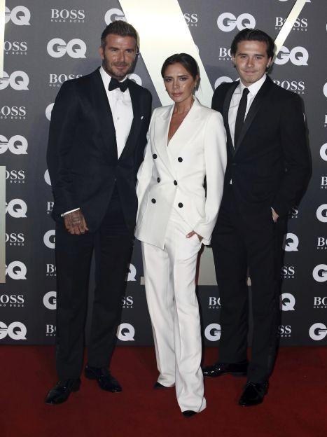 Вікторія Бекхем із чоловіком Девідом і старшим сином Брукліном / © Associated Press