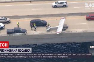 Новости мира: в США парень безопасно посадил поврежденный самолет на мосту