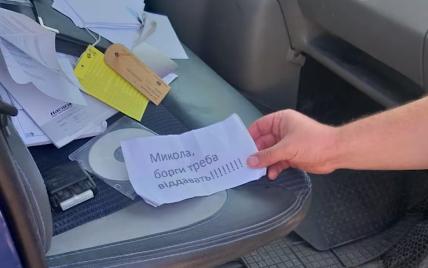 Під Києвом чоловіку за борги заклали вибухівку у відро: відео