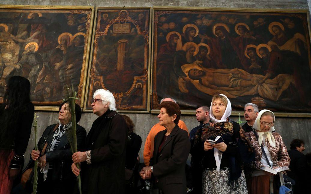 Христиане в Храме Гроба Господня в Старом городе Иерусалима, Израиль / © Reuters