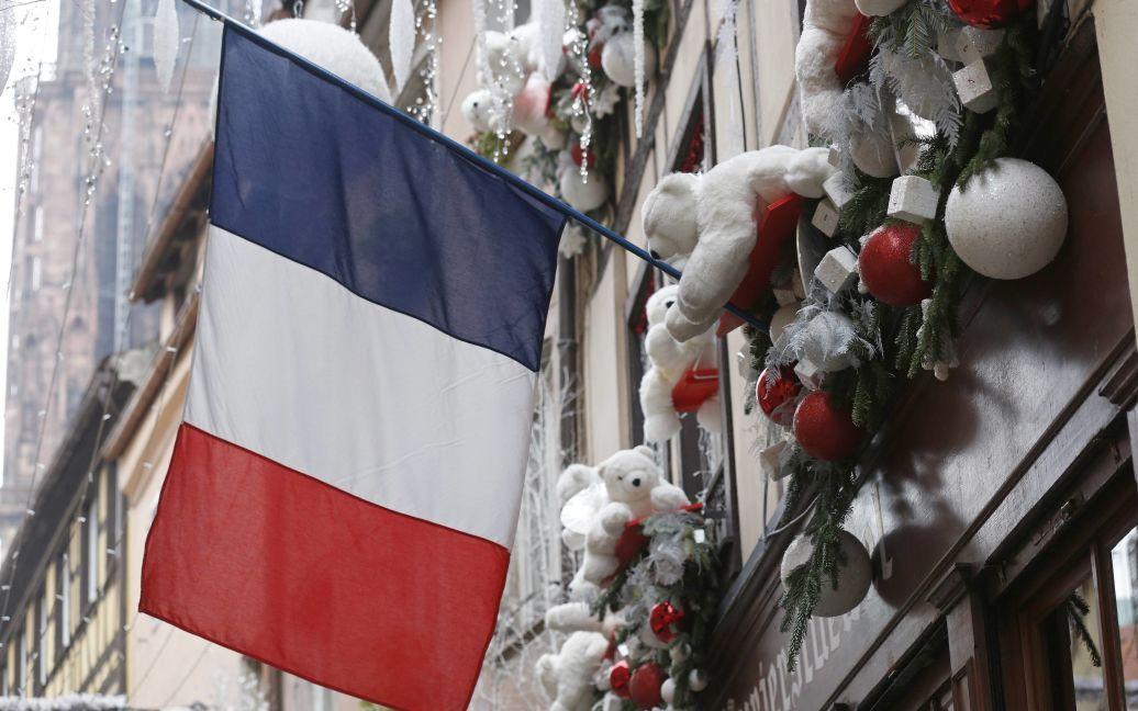 По всему Парижу развеваются флаги Франции. / © Reuters